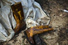 Botas manchadas aceite Imagenes de archivo