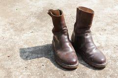 Botas marrons velhas Fotos de Stock