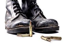 Botas y balas del ejército Fotos de archivo libres de regalías