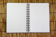 Botebook on bamboo background. Stock Images