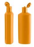 Botella anaranjada del champú Imagenes de archivo