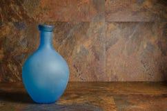 Botella azul Foto de archivo libre de regalías