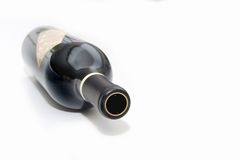 Botella caida Imagenes de archivo