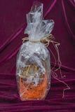 Botella como regalo Foto de archivo libre de regalías
