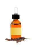 Botella con el aceite de la esencia aislado en blanco Fotos de archivo libres de regalías