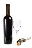 Botella con el vidrio de vino rojo y el sacacorchos Foto de archivo