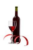 Botella con el vino rojo y el vidrio Fotografía de archivo