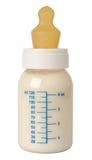 Botella con la leche para un bebé Foto de archivo libre de regalías