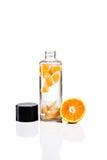Botella con la naranja Fotos de archivo libres de regalías