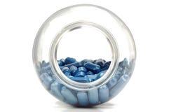 Botella con las tabletas azules Imágenes de archivo libres de regalías