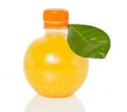 Botella creativa de zumo de naranja Imagen de archivo