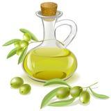 Botella de aceite de oliva y de una rama con las aceitunas Imágenes de archivo libres de regalías