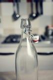 Botella de agua del vintage con la cápsula Imagen de archivo libre de regalías