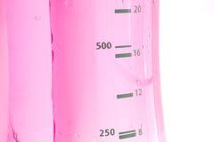 Botella de agua rosada Imágenes de archivo libres de regalías