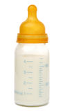 Botella de bebé con leche foto de archivo libre de regalías