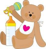Botella de bebé y babero Foto de archivo