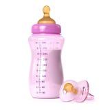 Botella de bebé y pacificador Foto de archivo libre de regalías