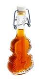 Botella de bebida alcohólica con la miel Fotos de archivo