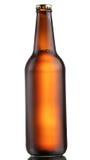 Botella de cerveza oscura fotografía de archivo