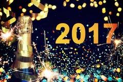 Botella de champán Feliz Año Nuevo Imagen de archivo libre de regalías
