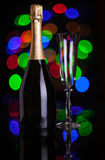 Botella de champán y de copa de vino Foto de archivo