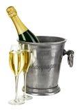 Botella de champán en cubo de hielo con el stemware aislado Imagen de archivo libre de regalías