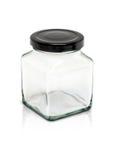 botella de cristal cúbica con el casquillo de aluminio negro Fotos de archivo