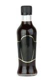 Botella de cristal con la salsa de soja Fotos de archivo libres de regalías