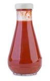 Botella de cristal con la salsa de tomate de tomate fotografía de archivo