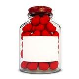 Botella de cristal con los corazones rojos Imágenes de archivo libres de regalías