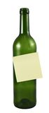Botella de cristal con una etiqueta engomada Fotos de archivo
