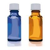 Botella de cristal marrón y azul vacía Imagen de archivo libre de regalías
