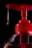 Botella de descenso del jabón líquido Fotografía de archivo