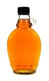 Botella de jarabe de arce Imagen de archivo libre de regalías