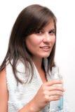 Botella de la explotación agrícola de la mujer joven de agua foto de archivo libre de regalías