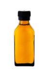 Botella de la medicina con el jarabe amarillo Fotos de archivo
