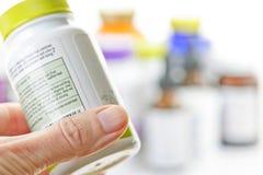 Botella de la medicina de la explotación agrícola de la mano Imágenes de archivo libres de regalías
