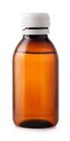 Botella de la medicina de plástico marrón en el fondo blanco Fotos de archivo