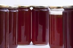 Botella de la miel Imagenes de archivo