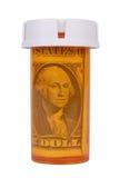 Botella de la prescripción con el dinero Foto de archivo libre de regalías
