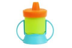 Botella de la taza del bebé Fotos de archivo libres de regalías
