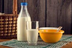 Botella de leche con el vidrio Imagen de archivo libre de regalías