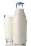 Botella de leche con glas Imagen de archivo libre de regalías