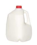 Botella de leche del galón con el casquillo rojo aislado en blanco Imagen de archivo libre de regalías