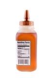 Botella de miel sin procesar Foto de archivo libre de regalías