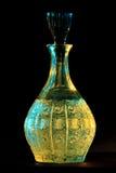Botella de oro Imagen de archivo libre de regalías