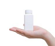 Botella de píldora a mano Fotos de archivo