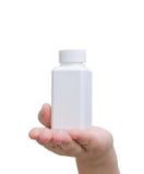 Botella de píldora a mano Foto de archivo