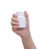 Botella de píldora a mano Foto de archivo libre de regalías