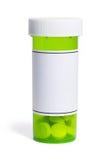 Botella de píldora verde Fotos de archivo libres de regalías